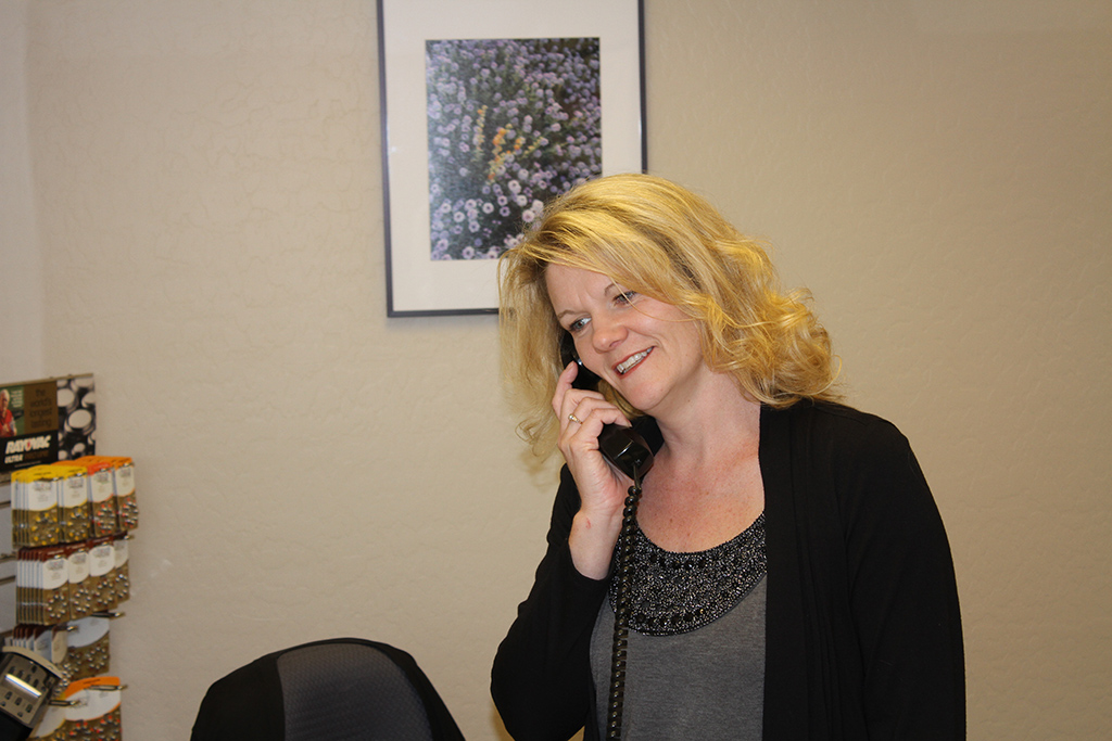 Desert Hearing Care – Mesa Office Manager Richelle Assisting a Patient on the Phone