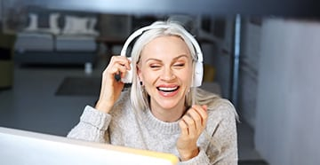 Lady with headphone smiling